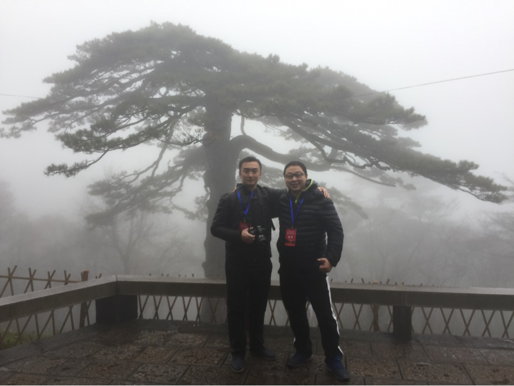 My colleague Mr. Qin and I at Black Tiger Pine Tree Near Beihai Hotel